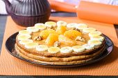 pic of condensation  - Homemade pastry cake with bananas tangerines and condensed milk - JPG