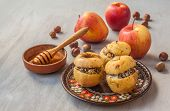 Baked Apples Stuffed With Raisins, Rice, Poppy Seeds And Honey
