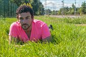 Handsome man in pink near railway