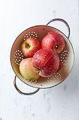 Freshly washed apples in a colander