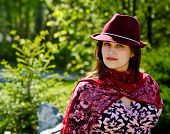 Women In Bordo Hat On The Park