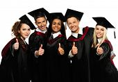 stock photo of graduation  - Multi ethnic group of graduated young students isolated on white - JPG
