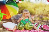 Cute little girl and a ripe watermelon.