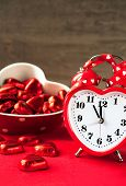 Valentine Love Heart Shaped Red Clock With Sweet Chocolates.