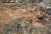 Damaged red brick wall texture
