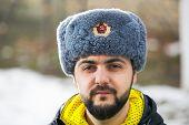 Caucasian man wearing ushanka winter hat with Soviet Union logo
