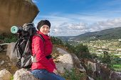 Girl With A Backpack In A Hike. Autumn In The Mountains.