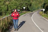 Girl On The Highway With A Backpack Going Camping. By Portugal.