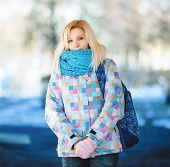 Cute blonde woman with backpack winter outdoors