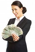 Businesswoman holding a clip of polish money.