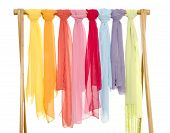 Color Coordinated Scarves Arranged On A Rack.