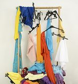 stock photo of untidiness  - Untidy wardrobe with colorful summer outfits and accessories - JPG