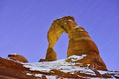 Startrails And Delicate Arch In Arches National Park, Utah In Winter