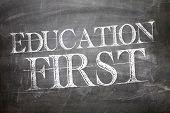 Education First written on blackboard