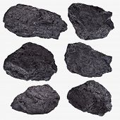 Coal lumps spilled on white background