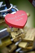 Love padlock on the railing of a bridge