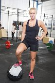 picture of workout-girl  - Attractive blonde girl rests after workout at a fitness gym center - JPG