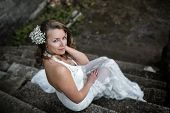 pic of stepping stones  - beautiful woman resting on the stone steps - JPG
