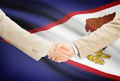 picture of samoa  - Businessmen shaking hands with flag on background  - JPG