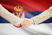 foto of serbia  - Businessmen shaking hands with flag on background  - JPG