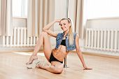 foto of pole dance  - Young Slim Pole Dance Blond Woman smile - JPG