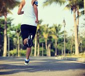 pic of jogger  - fitness jogger legs running at tropical park - JPG
