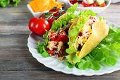 foto of tacos  - Tasty taco with vegetables on plate on table close up - JPG