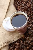 pic of sackcloth  - Paper cup of coffee with beans on sackcloth close up - JPG
