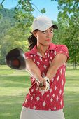 picture of ladies golf  - Portrait of beautiful golfer showing driver on golf course - JPG