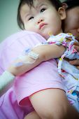 picture of intravenous  - Mother carrying her baby sick in hospitalshallow DOF saline intravenous  - JPG