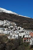 pic of snow capped mountains  - View of the village and snow capped mountains of the Sierra Nevada whitewashed village  - JPG