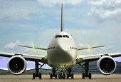 image of runaway  - Airplane on airport runaway under cloudy sky - JPG