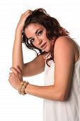 stock photo of blouse  - Tall slim brunette with red highlights in a cream blouse - JPG