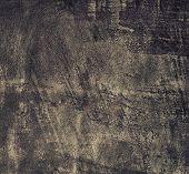 foto of stelles  - Closeup of grunge black metal plate as background or texture - JPG