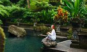 pic of tranquil  - Panorama pf young woman doing yoga outdoors in tranquil environment - JPG