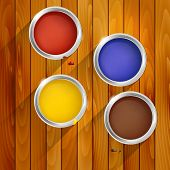 stock photo of oil can  - Cans of paint on a wooden background  - JPG