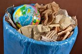 foto of save earth  - Globe in the garbage bin - JPG