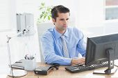 pic of concentration  - Concentrated businessman typing on the keyboard in the office - JPG