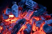pic of ember  - Red embers burning inside campfire  - JPG