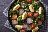 stock photo of sorrel  - Fresh salad with egg radishes and sorrel close up on the table - JPG