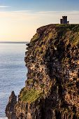 foto of cliffs moher  - Building on one of the Cliffs of Moher in Ireland  - JPG