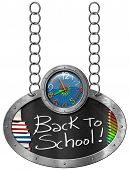 stock photo of oval  - Oval blackboard with a colorful clock text Back to School book and colored pencils - JPG