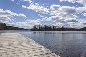 foto of dock a lake  - Dock stretches across Wawayanda Lake in early springtime - JPG