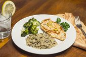 image of crispy rice  - Crispy tender lemon chicken garnished with lemon twist with sides of herb wild rice and lemon broccoli - JPG
