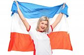 stock photo of holland flag  - A female sport fan smiling with holland - JPG