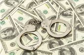 picture of snitch  - Handcuffs on money background - JPG