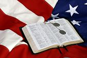 Bible with Dogs Tags on American Flag