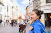 Shopping woman lifestyle in Copenhagen street. Scandinavian travel, tourist adult alone walking look poster
