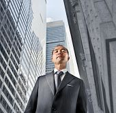 Japanese businessman with modern skyscrapers in the background