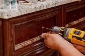 Cabinet Door Master Drills The Door In The Cabinet Door poster